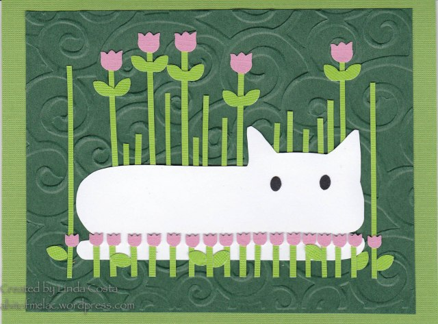62-LAC Cat with tulips 4-2014